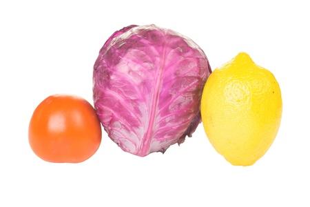 Tomato, cabbage and lemon isolated on white background photo