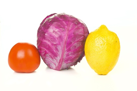 Tomato, cabbage and lemon isolated on white background photo