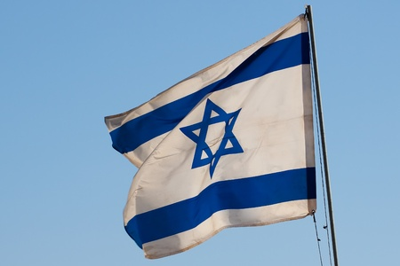 Israeli flag over the sky photo