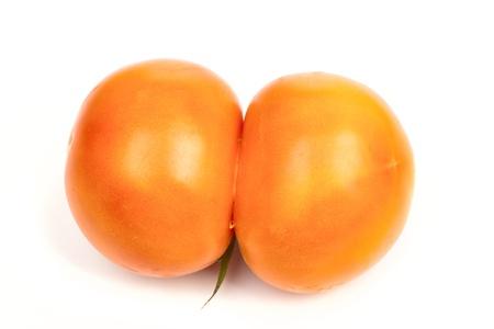 Ugly tomato isolated on white background photo