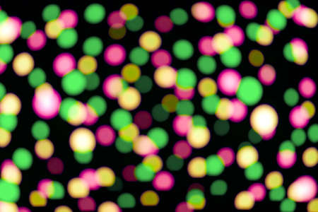 Defocused colorful lights on black background photo