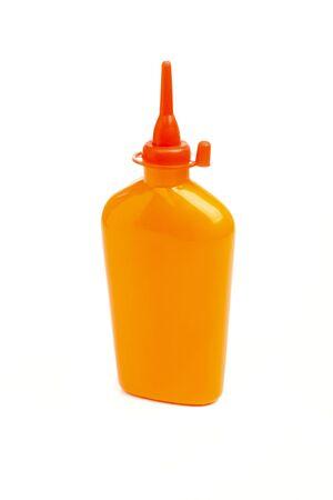 orenge: Orange plastic bottle with red nozzle isolated on white background