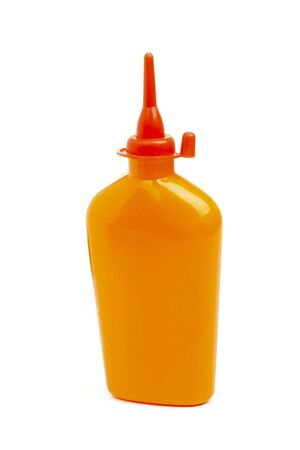 orenge: Orange plastic bottle with red nozzle isolated on white background