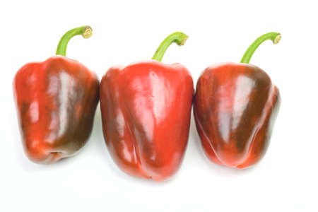 Three peppers isolated on white background Stock Photo - 13231663