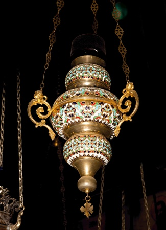 Icon-lamp in Marys Tomb, Church of Assumption, Jerusalem, Israel photo