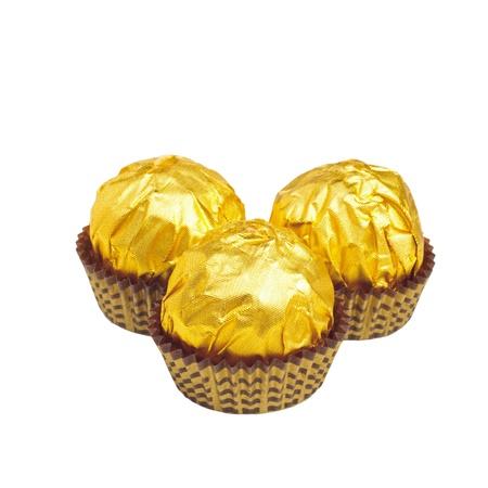 Golden candys isolated on white background Stock Photo - 13563303