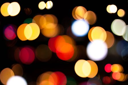 Bright defocused colorful lights on black background Stock Photo - 14458562