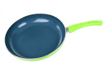 Simple single green pan isolated on white background photo
