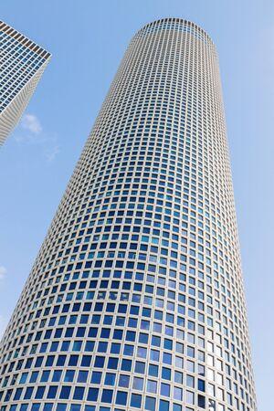 azrieli tower: The modern office building over a blue sky