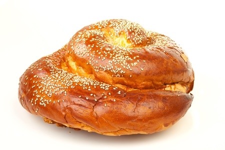 One sweet round sabbath challah isolated on white background photo