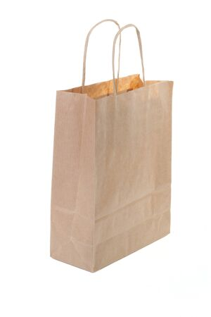 Single brown paper shopping bag isolated on white background photo