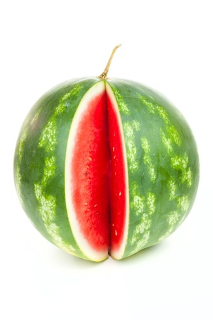 One notched striped watermelon isolated on white background photo