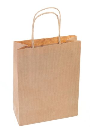 Simple brown paper shopping bag isolated on white background photo
