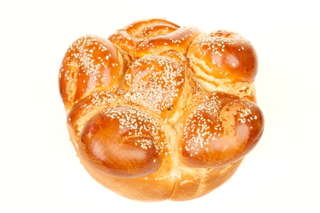 sabbath: One simple round sabbath challah with seed isolated on white background Stock Photo
