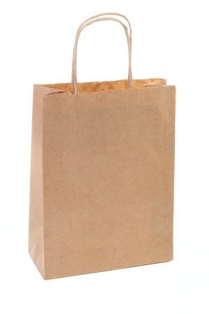 One simple brown paper shopping bag isolated on white background photo