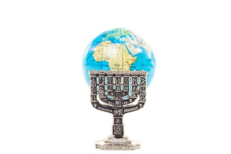 Silver Menorah and globe in shallow DOF isolated on white background photo