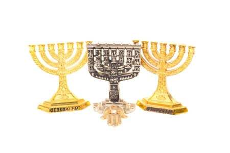 Three Menorah and golden hamsa isolated on white background photo