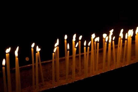 sepulchre: Candles in the Holy Sepulchre on Mount Calvary, Jerusalem, Israel