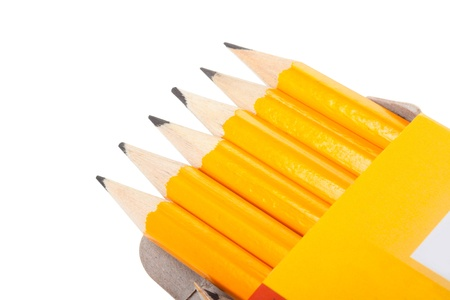 Six pencils in a box isolated on white background photo