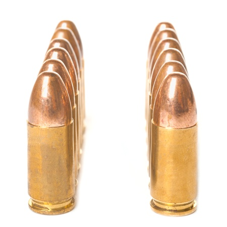 Two rows of  9mm bullets isolated on white background Stock Photo - 16949687
