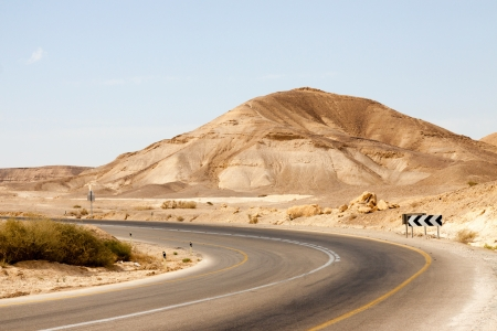 road marking: Big empty road with left turn in a mountains Stock Photo