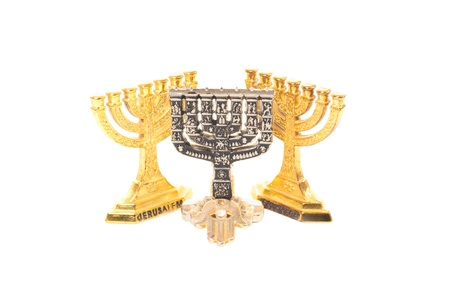 Three Menorah, two golden and one silver, and golden hamsa isolated on white background Stock Photo - 17595864