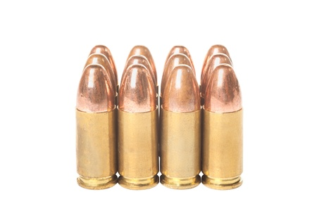 Twelve bullets caliber  9mm isolated on white background Stock Photo - 17595861