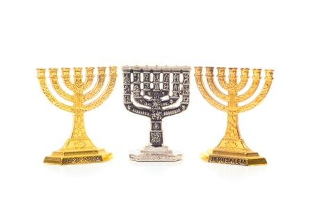 jewish group: Three Menorah isolated on white background