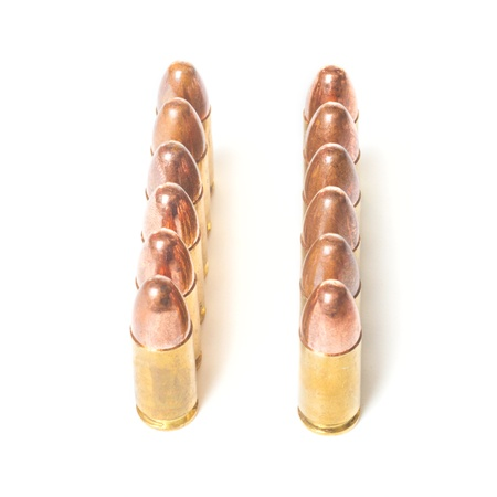 Two straight rows of 9mm bullets isolated on white background Stock Photo - 17933296