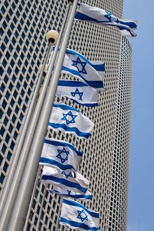 azrieli tower: Azrieli Center Tel-Aviv with flags Stock Photo