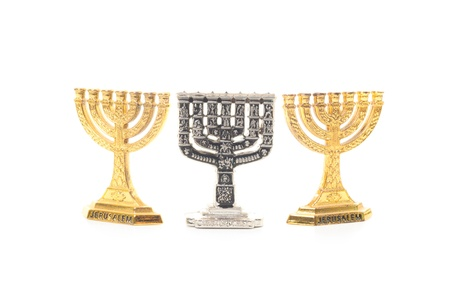 chanukkah: Three small Menorah, one silver and two another golden isolated on white background Stock Photo