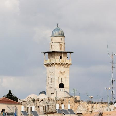 Old minaret near Wailing Wall in Jerusalem city photo