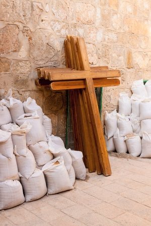 Wooden crosses and bags leaning the wall of Holy Sepulchre in Jerusalem photo