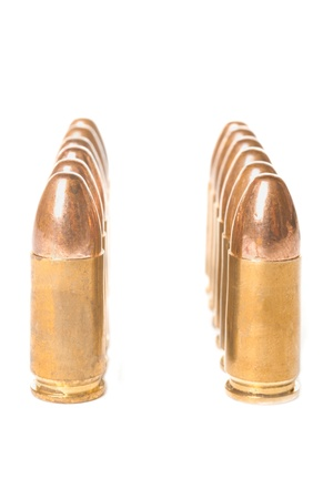 Two straight rows of scratched 9mm bullets isolated on white background Stock Photo - 18349712