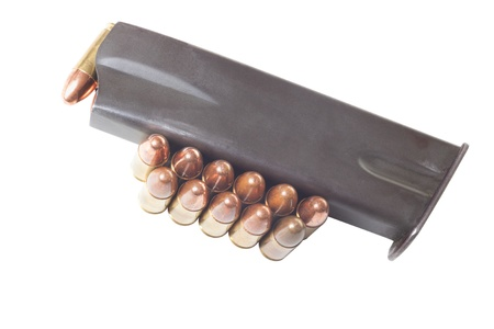 Armed gun holder and two rows of 9mm bullets isolated on white background Stock Photo - 18349731