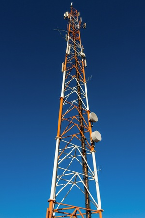 Antenna mast isolated on blue sky background photo