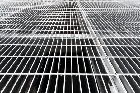 grates: Gray steell grates over a well Stock Photo