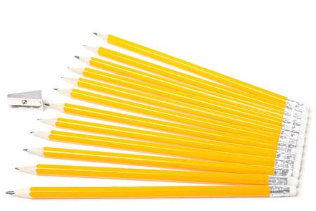 Group of new oranges pencils and pencil sharpener isolated on white background photo