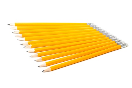 Group of twelve new yellow pencils isolated on white background photo
