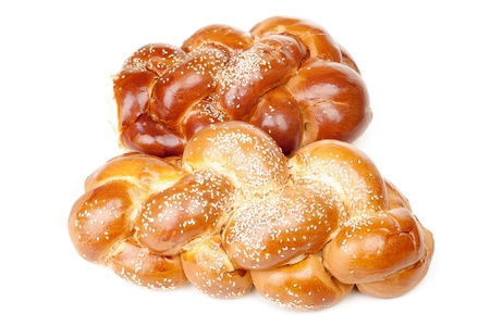 Pair of braided shabbat challah isolated on white background photo
