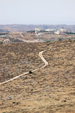 Road to a Palestinian village in a mountain near Hebron photo
