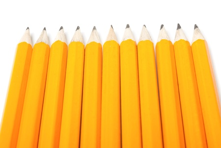 acute angle: Group of eleven new yellows pencils isolated on white background Stock Photo