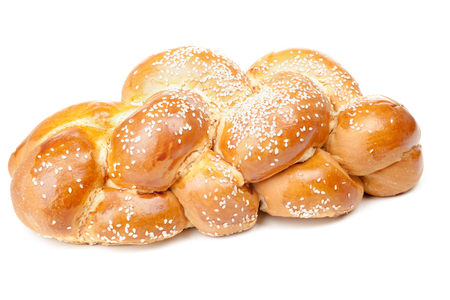Light braided challah with seeds isolated on white background