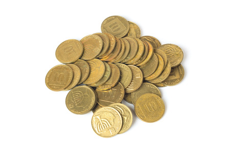 sheqel: Heap of israeli coins ten agorot isolated on white background
