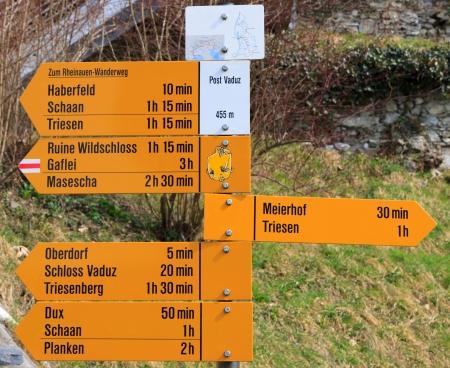 Orange signpost on the main pedestrian street in Vaduz, capital of Liechtenstein photo