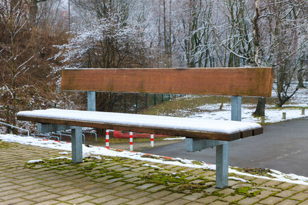 Lonely bench under the snow