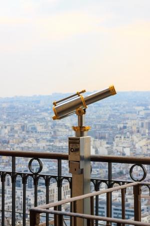 Spyglass on second floor Eiffel Tower in Paris, France photo