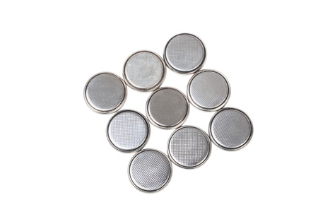 Round batteries isolated on white background photo