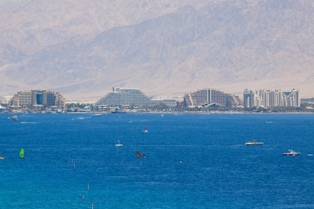 Eilat  Israel - 23, April 2011: The Red Sea, beaches, yachts and hotels against high mountains