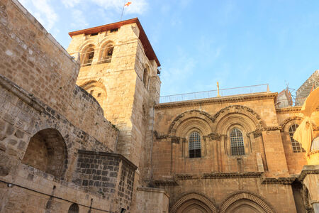 Belfry and courtyard at the entrance to the Temple of the Holy Sepulchre on sunset in Jerusalem photo